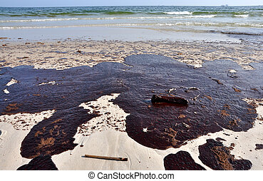Oil Spill on Beach - Oil spill on beach with off shore oil...