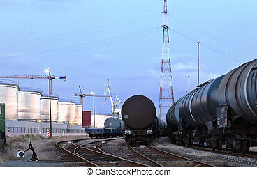 Oil tank cars in twilight - Oil tank cars standing on rail...