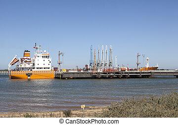Oil tanker in industrial port
