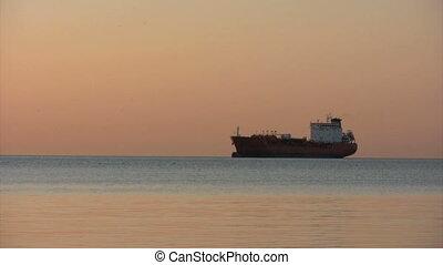 oil tanker at sunrise