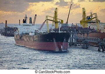 oil tankers unloading at sea