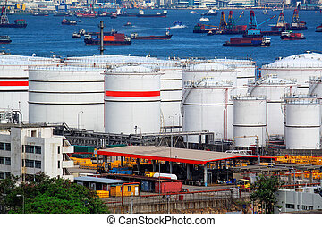 Oil tanks and ship at day
