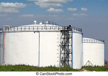 oil tanks and workers industry zone