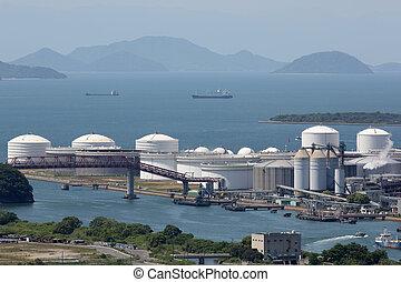 Oil tanks in sea port - Industrial fuel storage tanks at oil...