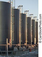Row of oil tanks in tank farm