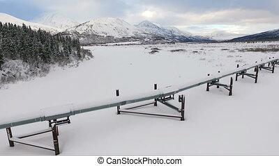 Oil Transport Alaska Pipeline Cuts Across Rugged Mountain...