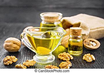 Oil walnut in sauceboat on board