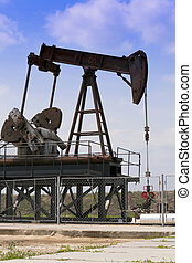 Oil well in the blue sky.