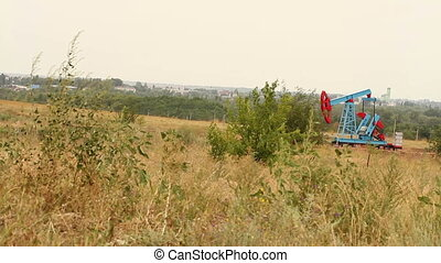 Oil well in the field. Landscape