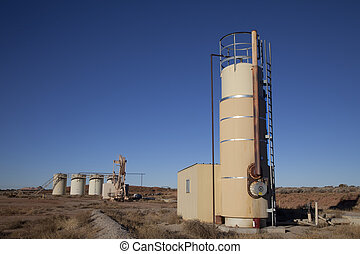 Oil well in the desert with blue sky