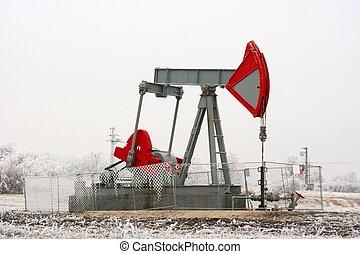 Oil well on a winter landscape
