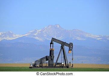 Pump jack oil well with Long's Peak