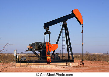 Oil well pump in West Texas showing horse head and walker beam