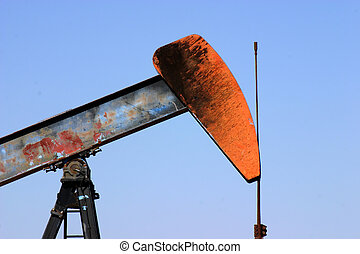 Oil well pump showing walking beam horse head and polished rod