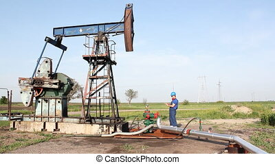oil worker check pump jack