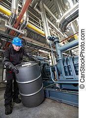 Oil Worker inside refinery - Oil Worker in helmet and ...