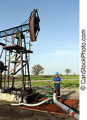 oil worker with tablet pc check pipeline