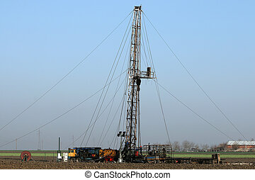 oil workers with land drilling rig