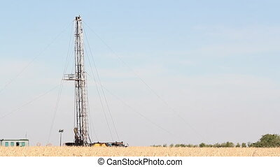 oilfield with oil drilling rig