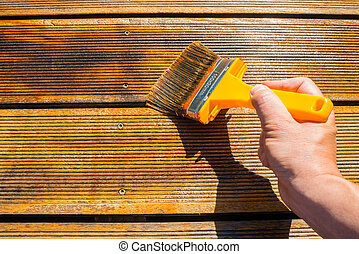 Oiling Terrace with Wide Brush