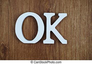 OK alphabet letters on wooden background