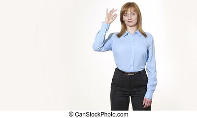 OK gesture. girl in pants and blous.  Isolated on white background. body language. women gestures. nonverbal cues