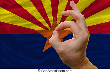 ok gesture in front of arizona us state flag
