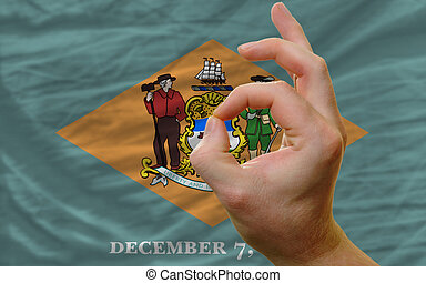ok gesture in front of delaware us state flag