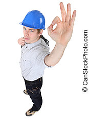 OK hand gesture from an electrician