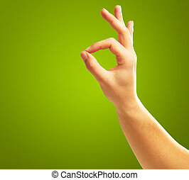 Ok Hand Sign On Green Background