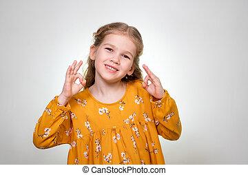 Ok Sign shows little blonde girl fingers 2 hands.