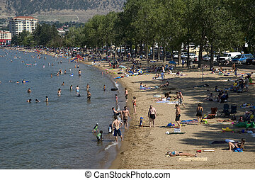 Beach with swimers by Penticton