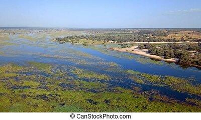 Okavango delta river on Namibia and Angola border - Aerial...