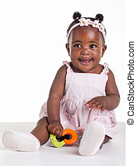 Little African girl are being photographed in the studio.