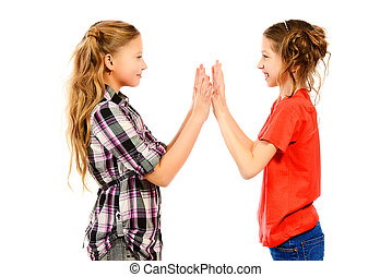 okay play - Two smiling girls standing together and playing....