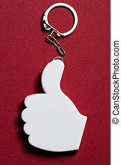 Okay sign badge on metal key ring