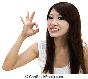 Woman giving ok hand sign shot on white background