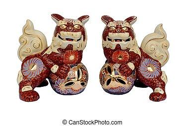 Okinawan shi shi dog figurines isolated on a white backgroun