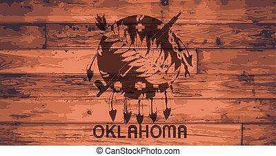Oklahoma State Flag branded onto wooden planks
