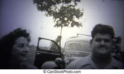 OKLAHOMA, USA - 1943: Couple walk toward camera - Original...