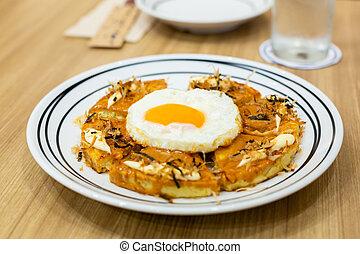 Okonomiyaki, Japanese Pizza on the wooden table. - ...