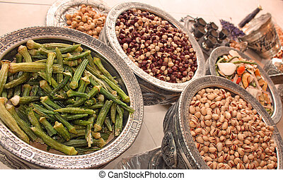 okra, nuts and dried fruit in bowls
