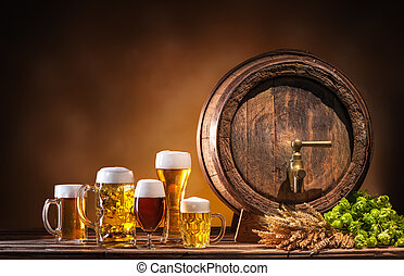 Oktoberfest beer barrel and beer glasses with wheat and hops...