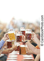 Oktoberfest beer drinkers raise glass