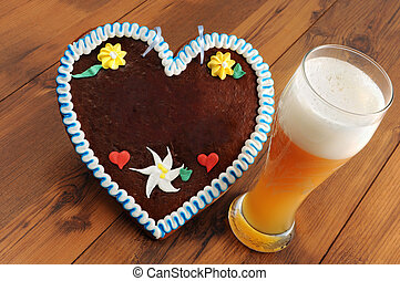 Oktoberfest gingerbread heart cookie with copy space and weissbier glass