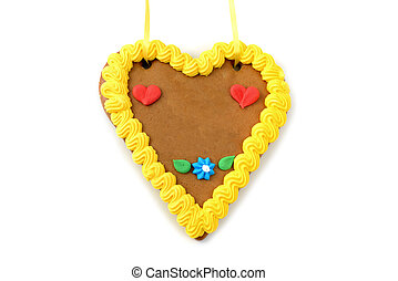 Oktoberfest gingerbread heart cookie with copy space on white isolated background