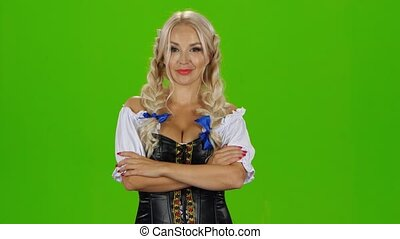 Oktoberfest girl with beer. Bavarian girl. Green screen