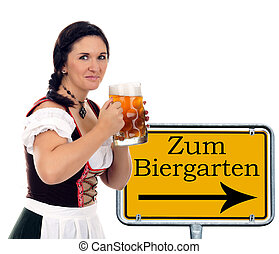 Oktoberfest - pretty women in dirndl and sign with the...
