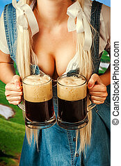 oktoberfest woman holding two beer mugs - young sexy...