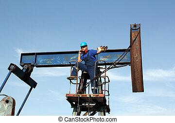 olaj munkás, társalgás mobile telefon